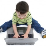 Laughing Boy on Laptop with Clipping Path